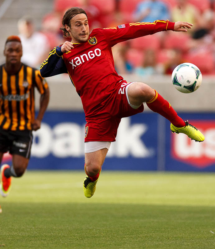 Real Salt Lake's Ned Grabavoy leaps for the ball as Real Salt Lake hosts Charleston Battery in the US Open Cup Wednesday June 12, 2013 at Rio Tinto Stadium in Sandy, Utah